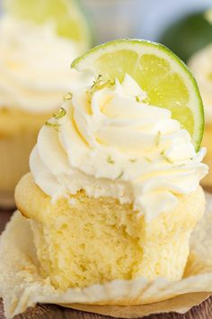 Margarita Cupcakes - A vanilla cupcake with vanilla frosting, lime zest and a lime wedge has a bite taken out of it. Margarita Cupcakes, Tequila Cupcakes, Alcoholic Cupcakes, Cupcake Recipes, Baking Recipes, Cupcake Cakes, Gourmet Cupcakes, Cup Cakes, Vanille Cupcakes