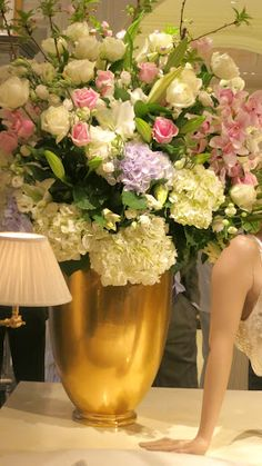 An absolutely stunning  floral arrangement of roses, hydrangeas, lilies, and orchids