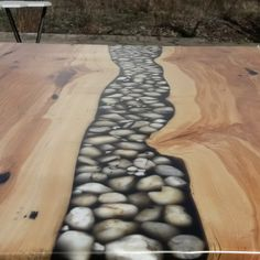 A ash table with a river stone in a black transparent epoxy resin