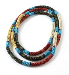 Coral Snake Crochet Bead Rope by Dorothy Siemens. 53 inches long.