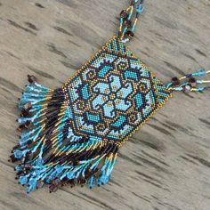 """Beaded pendant """"Magic Flower"""" - peyote necklace, blue, gold, emerald green, boho, fringe, via Etsy."""