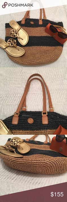 Tory Burch Beach Bag Navy & Camel Tory Burch Beach Bag Navy and Camel Straw. In good condition. No rips, holes and comes from a smoke free home. Always authentic. 18 in across 14 in length and 5 in depth approximately. Tory Burch Bags Shoulder Bags