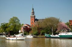 https://flic.kr/p/6hEJwi | Town hall | The town hall of my home town Leer, viewed from the opposite side of the harbour, Lower Saxony, Germany. When I was young I used to fish for Zander and Eel from a boat at night. A magical setting!