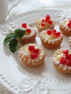 Pretty pomegranate tarts with vanilla custard