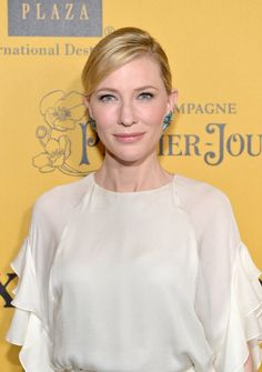 Pin for Later: Stop and Stare! Karlie Kloss Is a Bronzed Goddess Cate Blanchett Cate sported natural makeup and an elegant updo with a deep side part at the Women in Film 2014 Crystal + Lucy Awards.