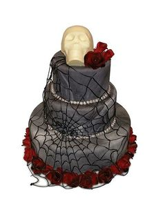 This cake is from Cake Alchemy.  I saw her make it on Amazing Wedding Cakes (she's the only reason I even watch that show).  It's red velvet and I always thought this was an awesome fricken cake