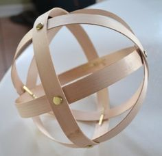 diy for pendant light or just for decoration...veneer strips, wood glue, and brass fasteners