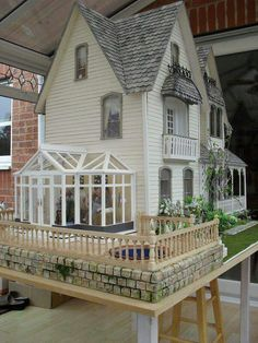 Beautiful dolls house with conservatory