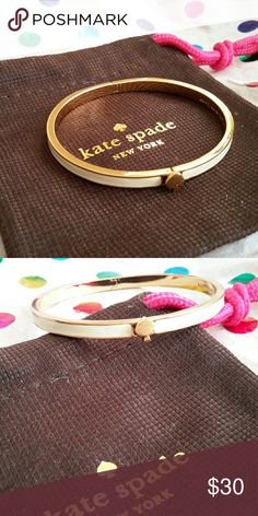 Kate Spade Bangle Cream hinged bangle w/gold spade. Has a little scratch on the spade and bottom. Jewelry Bracelets