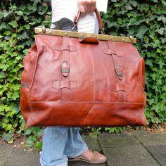 Vintage Leather Doctor Bag Brown Leather Metal Frame. $84.00, via Etsy.