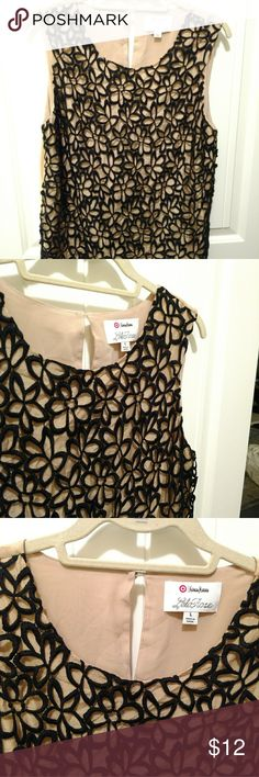 Fun Neiman Marcus Shirt Cut outs make it super stylish, dress up or down. Excellent condition. Neiman Marcus Tops Blouses