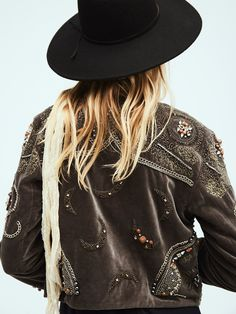 Moon Dance Jacket   Soft-to-the-touch cropped jacket with an open design featuring gorgeous embroidery and eye-catching embellishments throughout including chains, stones and beads. Back has mystical moon shapes. Subtle front hook-and-eye closure. Lined.