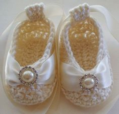 Baby Booties. You could put a button on a plain pair of booties, then have different bows that you can change out!!!