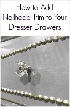 See how to create a decorative trim on painted furniture makeovers using upholstery tacks. Painted dresser with clear crystal knobs and nailhead drawers.