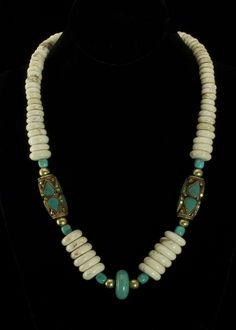 """White Turquoise Brass Necklace  White and blue turquoise beads, brass spacer beads, brass toggle clasp. Tibetan brass and turquoise hand made 1-1/2"""""""" oblong beads. Necklace is 22"""""""".   http://www.sterlingjewelrystores.com/product551.html"""