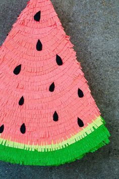 DIY watermelon pinata. Am I weird to think that would make for adorable decor?
