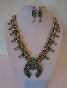 Zuni Needlepoint Turquoise Sterling Silver Squash Blossom Necklace and Earrings Circa 1970's by LunaBellaForever on Etsy https://www.etsy.com/listing/220820200/zuni-needlepoint-turquoise-sterling