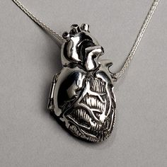 "The original Anatomical Heart Locket, by Peggy Skemp, is an intimate sculptural scientific illustration that invites exploration. The necklace features a 1.5""x .75""x .5"" anatomically correct human heart which opens to reveal a meticulously detailed interior. It is pleasantly solid in cast and fabricated .925 sterling silver."