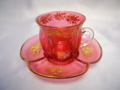 Listed here is a lovely antique Moser glass cranberry colored fluted cup and saucer, dating ~ Both pieces are beautifully hand cut and gold gilded Glass Coffee Cups, Coffee Cups And Saucers, Teapots And Cups, Tea Cup Saucer, Teacups, Tea Party Setting, Mad Hatter Tea, Venetian Glass, Carnival Glass
