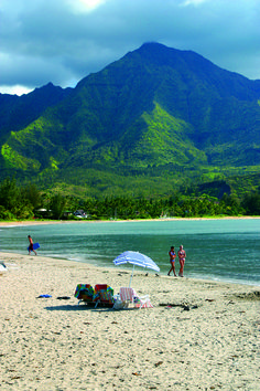 Hanalei Bay on Kauai's North Shore, with nearly two miles of beach, surrounded by mountains.