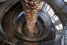This 3 story tall tower of books features different titles about President Lincoln. The tower is on display at the new Washington DC Center for Education and Leadership, a museum focused on Lincoln& legacy. Washington Dc, Abraham Lincoln Books, Jenga Tower, Instalation Art, Ford, Book Sculpture, Sculptures, Book Nooks, Books