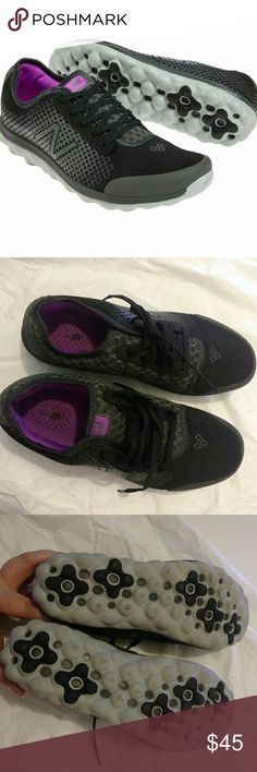 New Balance women's walking sneakers size 9D This is a pair of super light women's walking sneakers by New Balance in size 9D. They are black and gray, with purple accents. Worn once while on a treadmill so there is signs of wear on the bottom treads from the friction of the belt (this is shown in image 3). Otherwise in pristine condition. New Balance Shoes