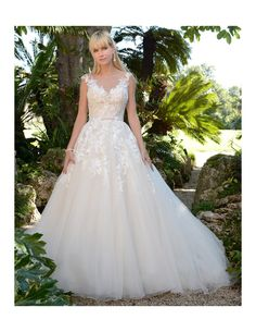 Make your fairytale dreams come true in this gorgeous lace ballgown! Available at Spotlight Formal Wear! #SpotlightBridal