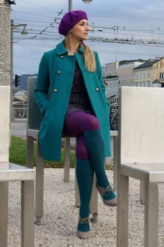 Alright, pick tights OR socks. Both just looks stupid. I do love the coat and the teal & purple color combo though.