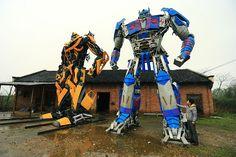 Transformer-like robots built by Yu Zhilin and his son, Yu Lingyun out of scrap metal