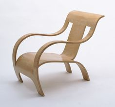 Gerald Summers, Armchair, 1933-34. This lounge chair was designed for use in tropical conditions. Because traditional wood joinery is adversely affected by increased humidity, this chair was constructed from a single piece of bent plywood.