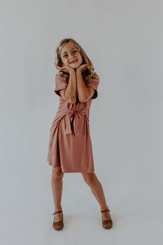 Model is wearing size Approximate measurements from neck to hem: - Length: - Length: - Length: - Length: Color is mauve with a wrap detail Rayon / Spandex dry clean only Girls Short Dresses, Mini Me, Dress First, Mauve, My Girl, Wrap Dress, Kids Fashion, Model, Nova