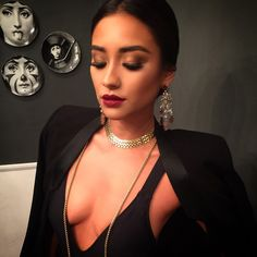 Shay Mitchell's makeup looks perfect with her sleek hair. | Pretty Little Liars