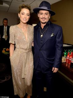 Hollywood couple: Amber Heard and Johnny Depp brought old-school glamour on Sunday to the Hollywood Film Awards in Beverly Hills, California
