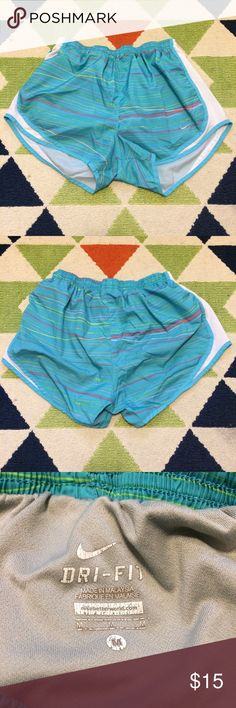 Nike Dri-Fit Shorts Great condition, only real signs of wear is fading on the tag. Blue shorts with multicolored stripes. These come with an underwear liner. Nike Shorts