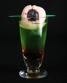 Bloody Eyeball .. lychee . blueberry . toothpick (or freeze into ice cubes)