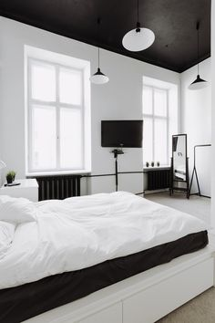 Black and white themed room - Why You Should Ditch your Traditional Ceiling and Adopt Dramatic Black Ceilings