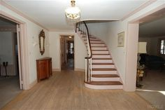 SCARSDALE, NY -- Stately and Spacious Brick Center Hall Colonial in perfect Fox Meadow location within walking distance to Scarsdale Schools, train station and Village. Welcome home to sunlit,oversized rooms, 2 fireplaces, curved staircase, leaded glass sidelights, 2+ car garage and CAC. Ideal for entertaining with first floor family room, living room with FPL,Formal Dining Room and private landscaped grounds. Four Huge Bedrooms offer Everyone Lots of Space and Privacy.