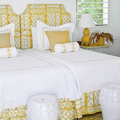 "Fabric covered headboard and matching slipcover ... cheap and easy!    ""The graphic floral patterns have a way of making upholstered headboards and pleated bed skirts look a little less buttoned-up,"" says Meg."