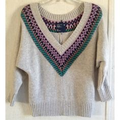 American Eagle Fair Isle Sweater Excellent condition. A little bit of pilling mostly under the sleeves. Really pretty American Eagle Outfitters sweater. Gray wool blend. Multi-color fair isle pattern around the neckline. Large v-neck. Dolman style oversized sleeve area. 3/4 length sleeves. Ribbed hem, collar, and cuffs. Size small. +All offers welcome American Eagle Outfitters Sweaters V-Necks