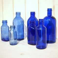 cobalt Blue and all shades of blue:  fragrance Niki de St. Phalle blank bottles from development days, apothecary, dug up on farm. simply the best.