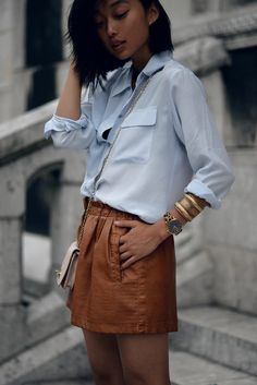 blue shirt + brown leather skirt #streetstyle