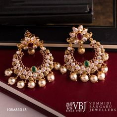 This beautiful chandbali earrings can make your look unique and grand; made with gold and added beauty of cubiczircon ruby emerald and pearls!Gross Wt : g. Gold Jhumka Earrings, Jewelry Design Earrings, Gold Earrings Designs, Gold Jewellery Design, Gold Jewelry, Diamond Jhumkas, Coral Earrings, Ear Jewelry, Fashion Earrings