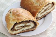 Beigli is an authentic Hungarian pastry roll that is often served for Christmas. It is sweet and has many varieties of fillings, the most common of which are poppy seeds and walnuts. Dissolve the yeast and granulated sugar in 1/4 cup of...