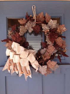 - This beautiful wreath is a twig wreath frame with a string of bronze colored leaf string covered in glitter - Burlap bows with wooden letters 'FALL' - Custom wreath can be created with different str