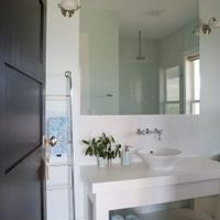 Glass mirrors may be glued to a wall due to their size and weight. If a mirror glued to a wall broke, most of the shards would stay on the wall instead of crashing down. This installation method also keeps mirrors from rattling or bowing, and doesn't require a frame or brackets. During a remodel, removing a glass mirror from a wall is difficult,...