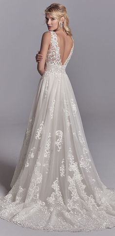 Gorgeous train and lace details on Oliver by Sottero and Midgley.