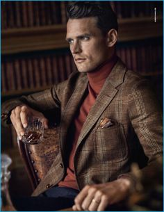Starring in Dunhill's fall-winter 2016 campaign, Guy Robinson channels English country style in a plaid sport coat and turtleneck.