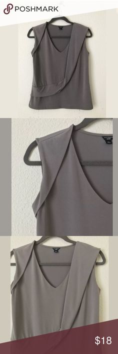 """Taupe Ann Taylor sleeveless top size 0P Petite Brand: Ann Taylor  Size: Petite Small Style/Details: Sleeveless  Color: Stone Materials: Shell: Polyester + Spandex  Lining: Polyester  Measurements: Length: 22.5"""" Shoulder to Shoulder: 15"""" Armpit-Armpit: 17"""" Waist: 16.5"""" Bottom Hem: 18"""" Ann Taylor Tops Blouses"""