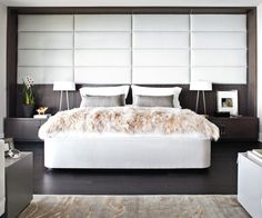 Stylish & Modern Bedroom with dark hardwood floors, neutral color scheme
