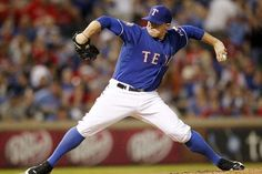 ARLINGTON, TX - MAY 14: Robbie Ross #46 of the Texas Rangers pitches against the Kansas City Royals on May 14, 2012 in Arlington, Texas. (Photo by Layne Murdoch/Getty Images) game 36